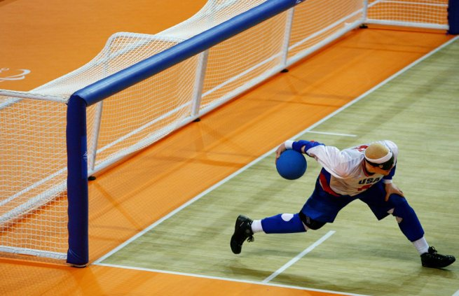 This event is called goalball and all the players are blind or wearing blindfolds. There is a little bell inside the ball to alert players to its presence.